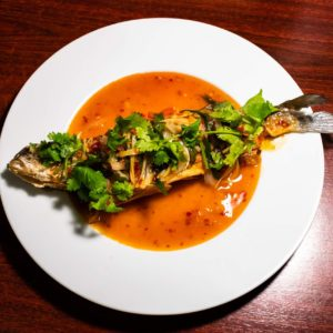 Fried whole fish in spicy sauce